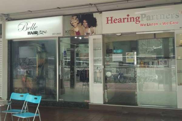 Woman pressing ear in pain